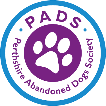 Perthshire Abandoned Dogs Society roundel with a paw print in the middle and purple text