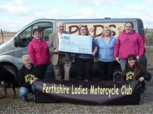 Handing over £500 cheque to Perthshire Abandoned Dogs Society